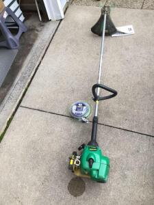 "Gas powered feather light 17"" cut 25cc Weed Eater, Model SST25 and two additional roles of trimmer line"