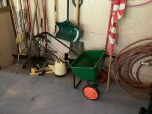 Rakes, shovels, brooms, sprinklers, Scott spreader, hula hoops, US flag, garden hose. See photos