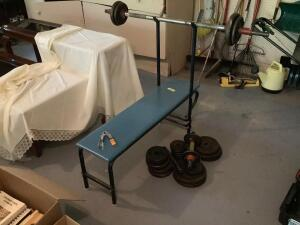 Weight bench with bar and weights.