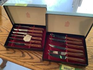 Two sets of six Kirk & Matz Forged Stainless Steel steak knives