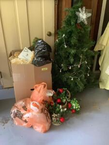 Holiday decorations--Christmas and Halloween.  Lighted tree measures approximately 4 1/2'
