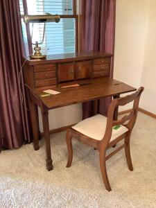 Ladies writing desk with fruitwood finish, brass tone two bulb student lamp and chair Desk measures 34 x 18 x 40