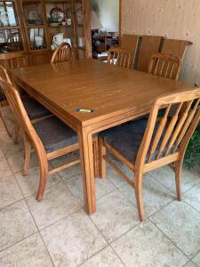 Dining table w 3 leaves and 7 chairs. Six chairs are padded and one is a captains chair. Table measures 59 x 40 x 30 and each leaf is 11""