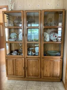 Lighted china cabinet with three glass front doors and triple door lower storage Measures 58 x 15 x 72  **No contents**