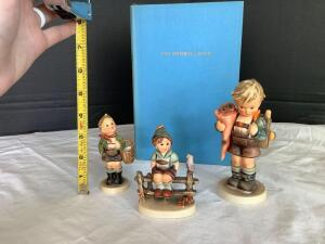Three Hummel figurines Wayside Harmony, Little Scholar and Village Boy and Hummel book