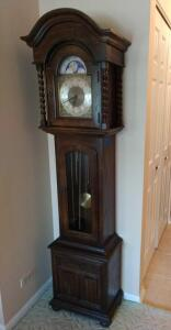 Ethan Allen oak grandmother clock with turned twisted columns, revolving moon face dial  Measures 18 x 10 x 72