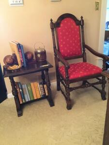 Side table w books and captains chair w/ red fabric cover (very different!) Table measures 22 x 15 x 22