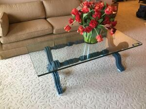 Glass top coffee table measures 55 x 26 x 19 and floral bouquet in a glass vase (vase broken in transit)