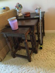 Ethan Allen nesting tables, coasters in wooden holder, candle and two porcelain bouquets