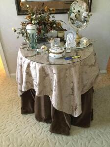 Round top glass covered table w/ linens, Willow Tree figurine, dresser tray and trinket boxes, clock, Lefton ring holder, floral decor