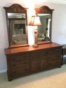 "Ethan Allen eight drawer dresser with double mirrors. Measures 74 x 20 x 84. Mirrors removed for moving We've also included a beautiful 36"" table lamp"