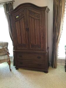 Ethan Allen armoire measures 41 x 20 x 75. It is two pieces for moving