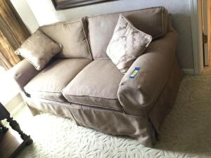 "Two cushion loveseat Measures 63""L"