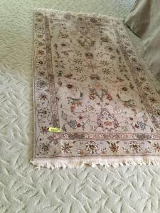 Two area rugs Measure 3' x 5' and 3 1/2' x 5 1/2'