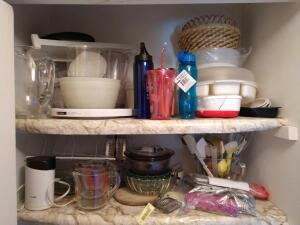 Misc. kitchenwares-pie plates, glass measuring cups, whisks and kitchen utensils, bowls, pitchers, plasticware, Tupperware.  Please refer to photos