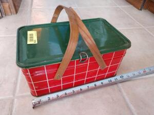 Antique tin picnic basket made of metal with wood handles