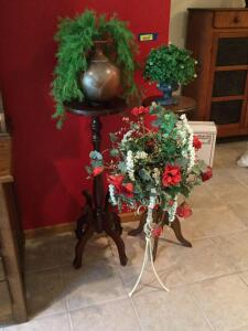 Plant stands of different sizes and styles and their pretty friends