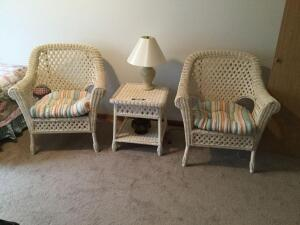 Very nice wicker set ? two arm style chairs with pads, square top table, table lamp and decor. Table measures 20 x 21