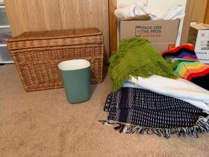 Wicker lift top storage trunk with duvet cover, afghans, area rugs, towels, other linens, and a trashcan trunk measures 26 x 16 x 16