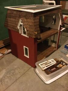 Cute little handmade dollhouse and accessories. Looks like it may have went through a hailstorm as the shingles have a little minor damage and damage to the roof. See photos