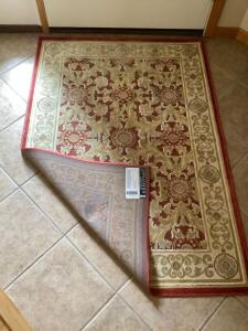 Area rug measures 3 x 4, wall mirror, wooden cookie press and home decor