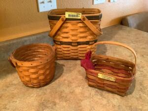 Three Longaberger baskets-one marked Christmas Collection 1987 Edition Mistletoe Basket, one marked Collectors Club Membership basket. Two w/ protectors and extra linersя