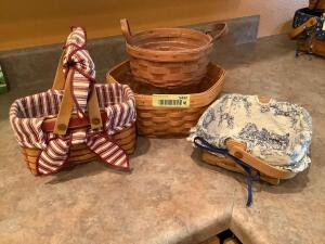 Four Longaberger baskets-all w/ protectors and 2 w/ liners