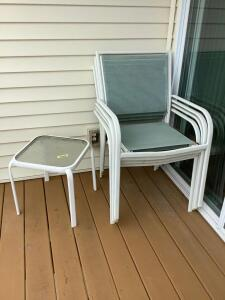 Four metal patio chairs, glass top side table measures 16 x 16 x 17 and square top patio table measures 40 x 40 x 28