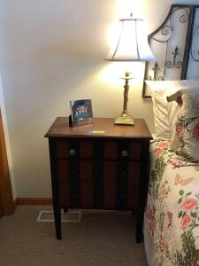 Three drawer night stand by Pier One Imports and table lamp. Measures 25 x 14 x 32