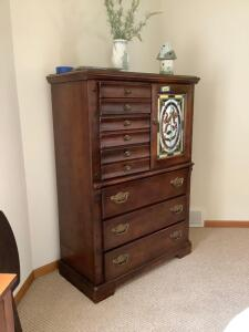 Six drawer dresser with small stained glass door that hides the included 19? flatscreen TV Measures 40 x 18 x 56