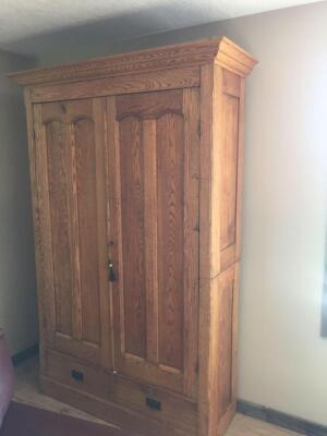 Oak vintage wardrobe with two drawers 48xl17x81. Key included. Beautiful condition. Top comes off to move. This is a heavy piece and is a stair carry