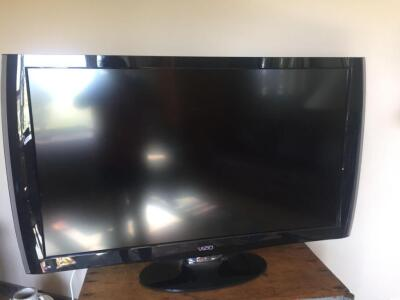 "47"" Vizio smart TV with base stand and remote"