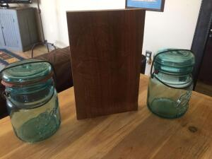 Two green ball jars, hand carved wood piece (mother and child) 5 1/2x 8 1/2