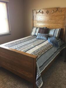Vintage tall Oak full size bed with mattress and box, headboard, footboard and rails included