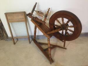 Vintage spinning wheel and washboard