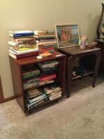 Bookcase filled with books measures 23 x 15 x 27 and side table with art measures 22 x 14 x 26