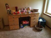 Nine drawer desk, boardgames, stuffed animals, candles, picture frames, photograph albums, baskets and a tote of wedding related items. Desk measures 54 x 18 x 28