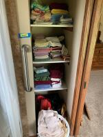 Bathroom closet full of towels, sheets and bags