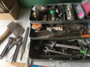 Metal toolbox filled with miscellaneous tools and items
