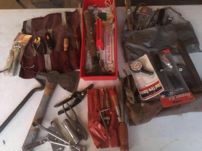 Assorted tools, crescent wrench, nail puller, hammers, tire gauge