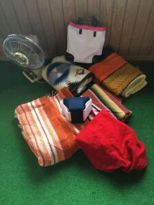 12 inch three speed oscillating fan, carry bag and assorted afghans
