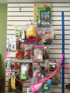 Cookie cutters, funny signs, cook books, cross stitch, kids play doh cutters. Shelf measures 28 x 12 x 33.