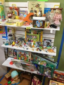 Children's puzzles, FP music box teaching clock, FP movie viewer and reels, marbles, plastic animal figurines, Tupperware Pop-a-Lot, paper dolls.