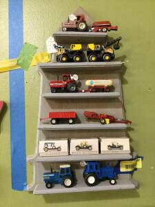 Display shelf w 1:64 scale tractors and implements.