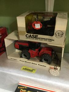 Ertl Case International tractor with front wheel drive assist 1:32 scale and Ertl Case IH 1:32 scale four-wheel-drive tractor