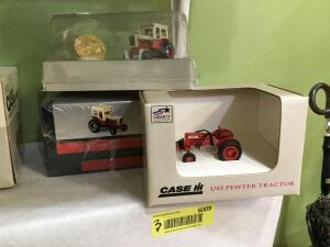 Case IH 1:43 scale pewter tractor, Case IH tractor with collector coin and Case IH tractor with collector coin in original packaging
