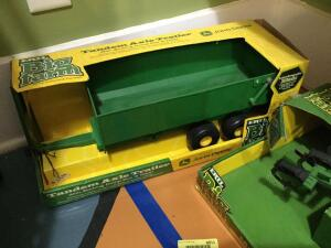 Ertl JD tandem axle trailer with working dump box and gate, and Ertl JD mulch ripper. These pieces are plastic.