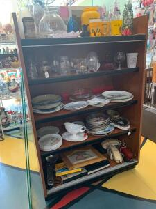 Cabinet and all contents-Pepsi bottles, Iowa Hawkeye items, candlestick holders, lantern globes, collector plates, milk glass, telephones, camera related items. Cabinet measures 36 x 18 x 54 and glass doors are available.