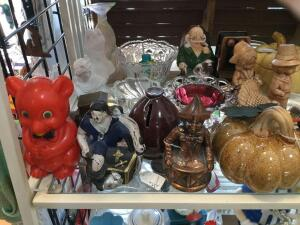 Various types of banks, busts, holiday items, Mickey Mouse and other Disney related items.