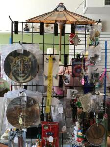 Costume jewelry – earrings and pins, pottery hangings, umbrella, decorative plates, wind chimes, towels, horse wallet, vintage hair rollers